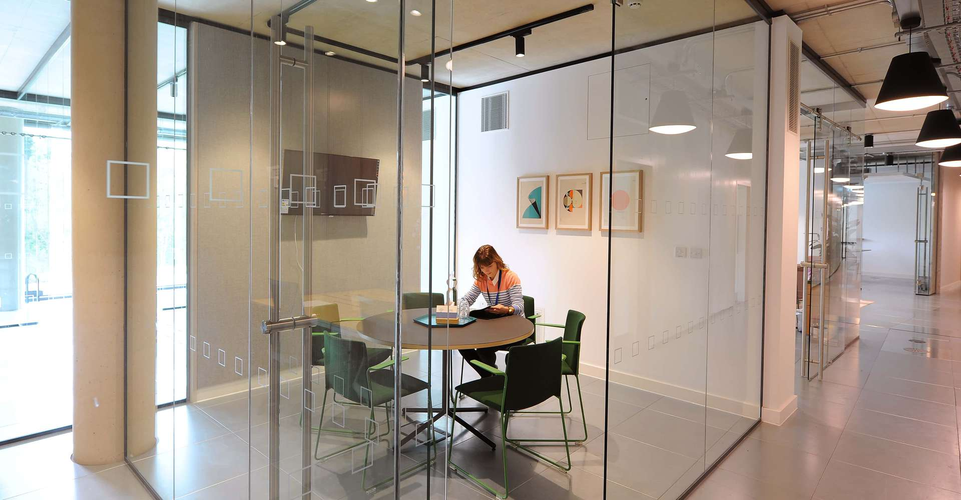 Businesswoman working in one of the Bradfield Centre's meeting rooms